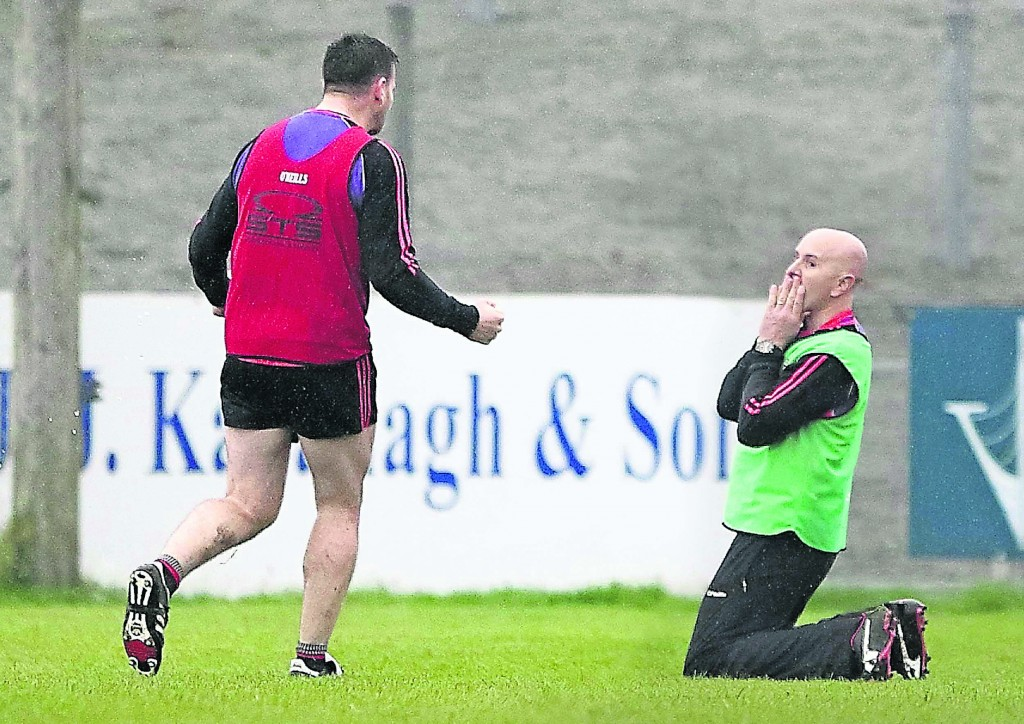 Ballygunner manager Fergal Hartley sinks to the ground as Wayne Hutchinson comes rushes to congratulate him at the final whistle of an extraordinary contest.