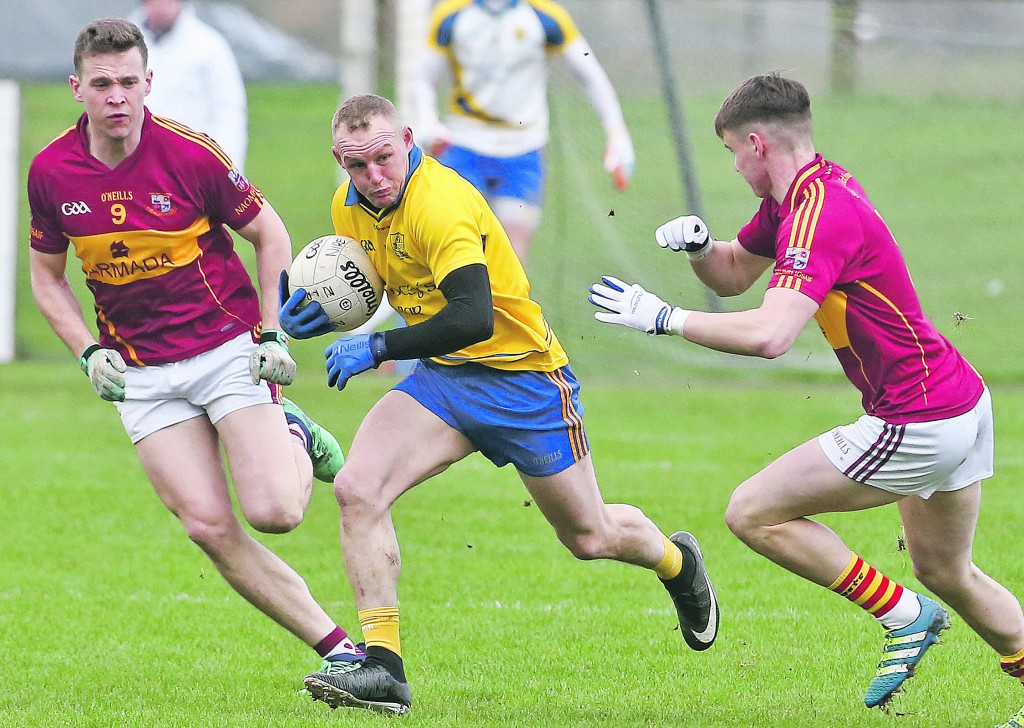 The Nire's Darren Guiry breaks clear of St Josephs' Darragh McDonagh and Oisin Looney at Fraher Field. 										| Photo: Sean Byrne