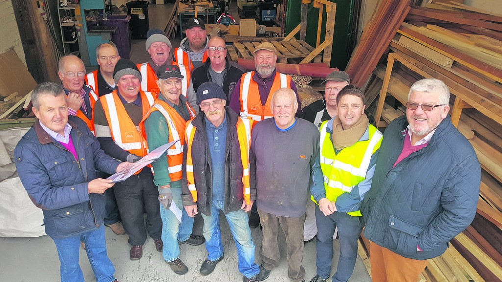 Members of the Déise Men's Shed, pictured with Martin and Mattie O'Shea of the Six Cross Roads Business Park, at the handing over of a further 12-month lease for the group, who have been on site for the past year