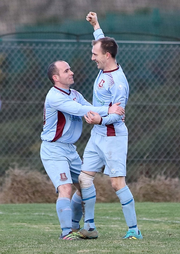Piltown's Jamie Waters is congratulated by team mate and fellow goal scorer Alan Walsh after he scored what proved to be the winning goal in the 61st minute of the game.  Photos: Noel Browne