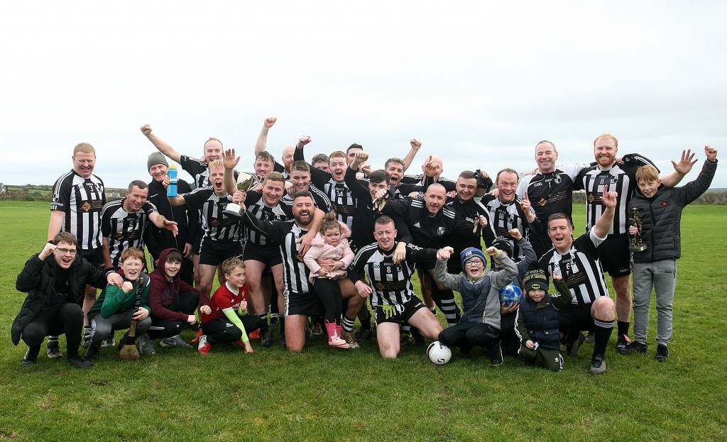 St Saviours celebrate following their win over Portlaw in the Whites Bar Eastern Junior 'C' Football Final at Dunhill on Saturday afternoon last.| Photos: Jim O'Sullivan