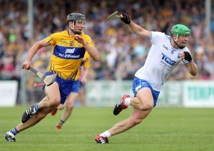 Waterford's Tom Devine gets past Clare's Cathal Malone during last May's Munster Championship opener.