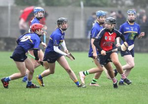 St.Angela's Abby Flynn surrounded by Doon players but still in possession