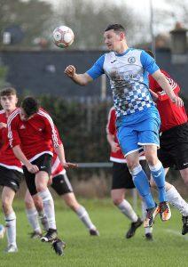 Hibs Gary Keane heads clear from a Borroway Rovers corner kick.