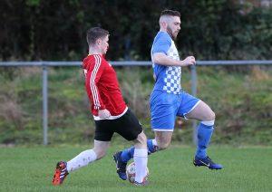 Borroway Rovers Shane Dunne tackles Hibs Mark O'Keeffe.