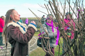 Participants tied Spring wishes on the Imbolc tree sculpture at the Hook Lighthouse during last year's festival.