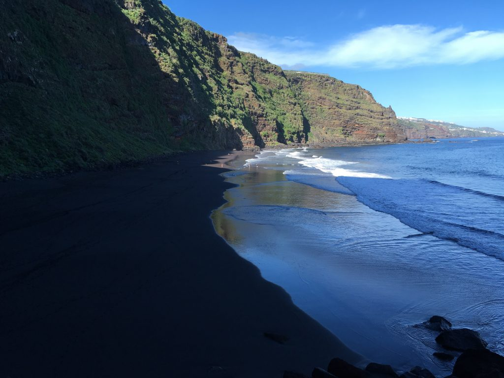 Playa Nogales with its black sand.