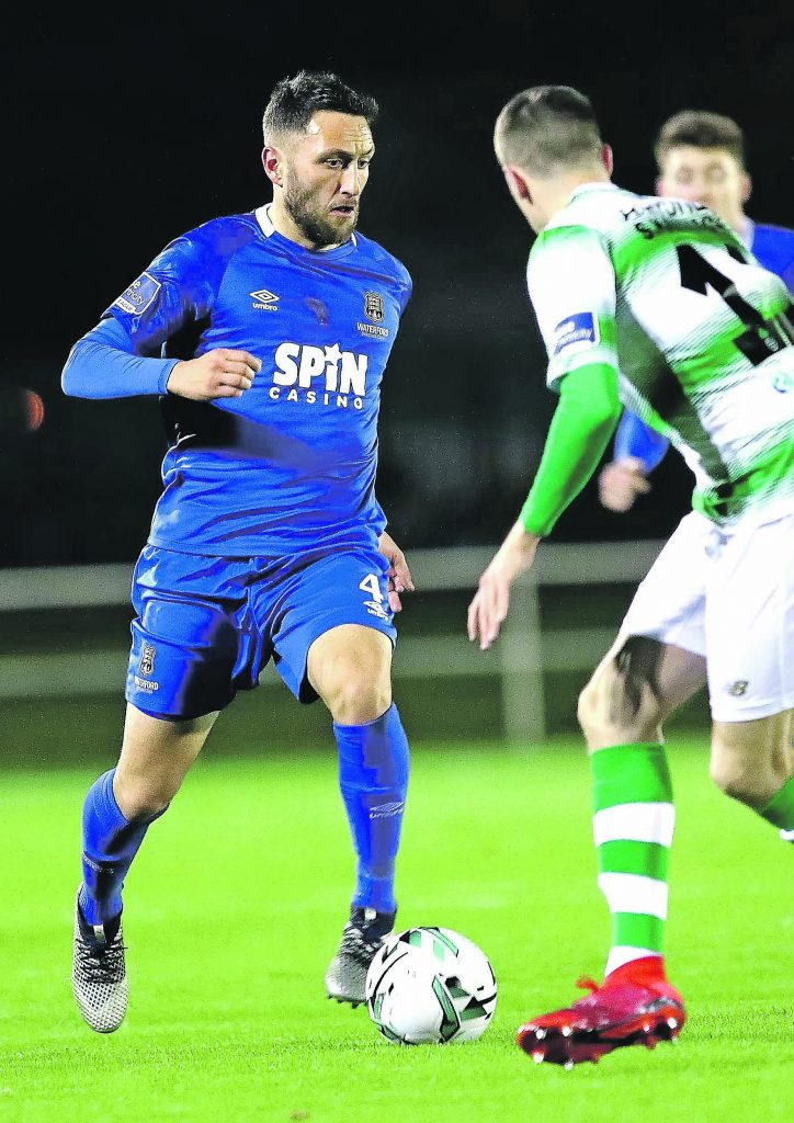 Waterford FC's Shane Duggan pushes forward against Shamrock Rovers Sean Kavanagh.