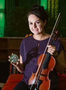 Tramore's Rebecca McCarthy-Kent, who won the Seán Ó Riada Gold Medal and €2500 in the final of the fiddle competition broadcast live on RTÉ Raidió na Gaeltachta from Cork's Rochestown Park Hotel last weekend. | Photos: Gerard McCarthy
