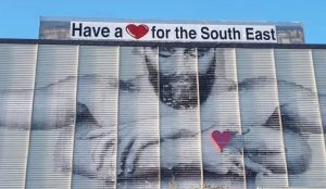 Waterford Castle Hotel has lent its support to the 'Have A Heart' campaign by emblazoning the slogan onto the Joe Caslin mural on the Ard Rí Hotel. | Photo: Waterford Castle