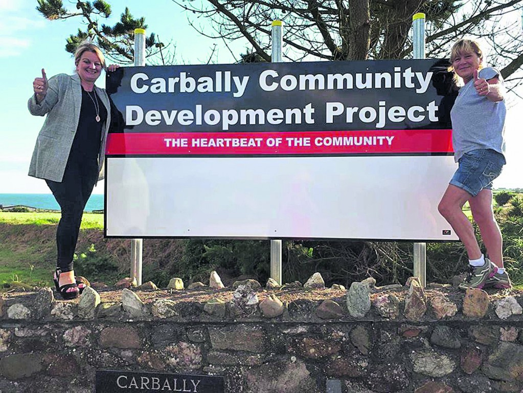 Eleanor Halley and Lucy Hogan pictured promoting the Carbally Community Development Project.