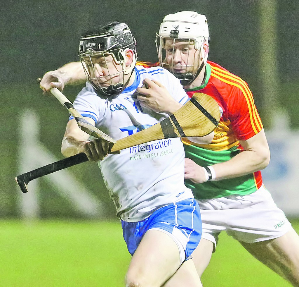 Waterford's Mikey Kearney coming under pressure from Carlow's Jack Kavanagh.