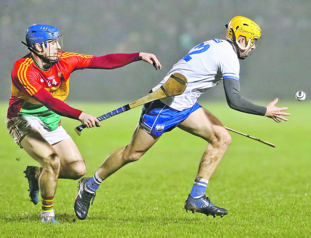Waterford's Jack Prendergast about to catch the sliothar despite the intentions of  Carlow's Martin Doyle. Photo by Sean Byrne