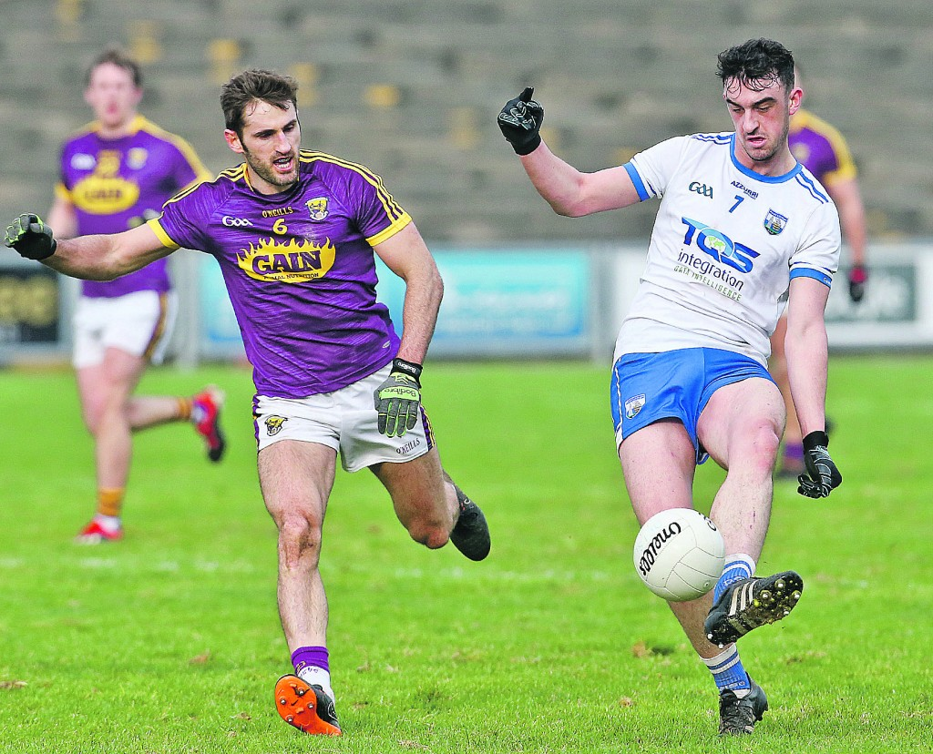 Waterford's Joe Allen moves the ball forward as Wexford's Brian Malone moves in during last Sunday's Division Four NFL meeting at Wexford Park.| Photos: Sean Byrne