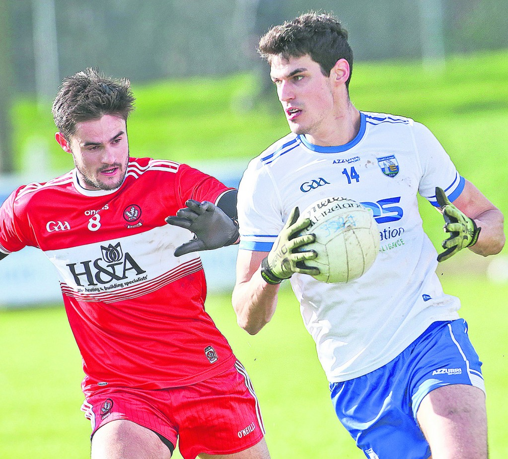 Waterford's Shane Ahearne steers away from Derry's Christopher McKaigue
