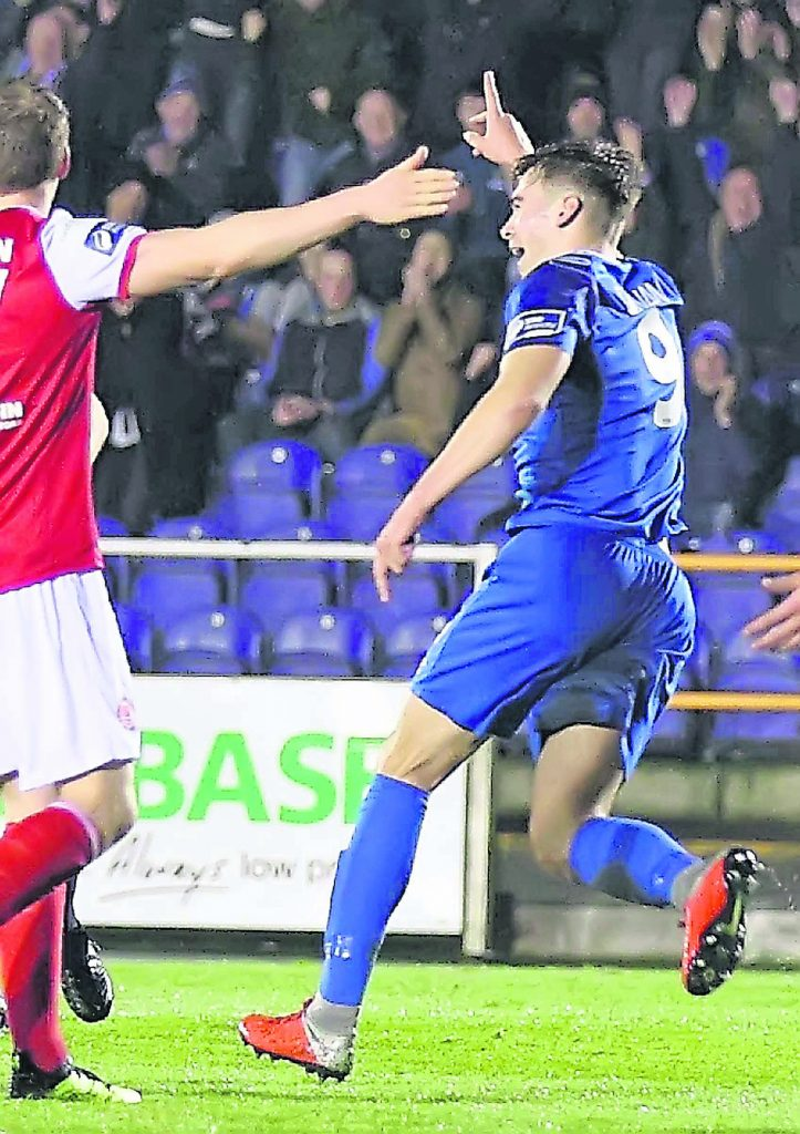 Waterford FC's Aaron Drinan peels away to celebrate after scoring his second goal of the game