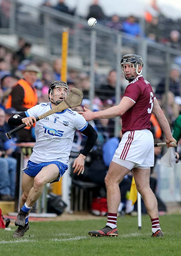 Waterford's Jamie Barron flicks the ball over the head of Galway's Aidan Harte during last Sunday's National Hurling League Semi-Final at Nowlan Park. See Sport 2-7 for more.  | Photo: Noel Browne