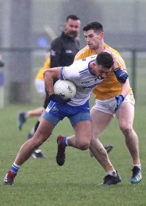 Waterford's Shane Ryan showing his strength when breaking the tackle of Antrim's Colum Duffin.