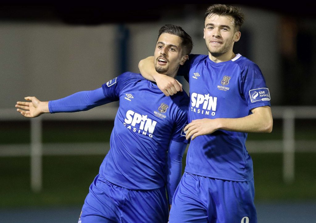 Waterford FC's Zack Elbouzedi is congratulated by team mate, Aaron Drinan after scoring the crucial second goal.