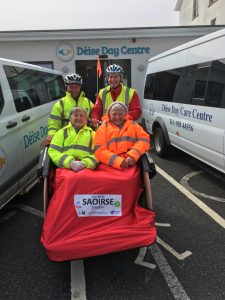 Volunteers Eddie Moore and Ger Wyley bring Hilda Riordan and Margaret O'Connor for a spin on a trishaw.
