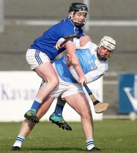 Mount Sion's PJ Fanning tussles with Roanmore's Emmet O'Toole during their Group B SHC clash at Walsh Park. | Photos: Maurice Hennebry