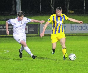 JJ Lunney on the ball for the Blues on the attack against UCD
