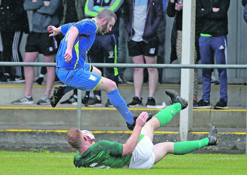 Ballinroad's Patrick Walsh makes a great tackle on Kilmacow's Noel Downey.