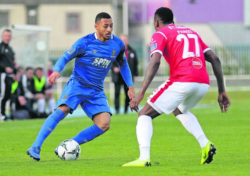 Waterford FC Aaron Simpson faces up to Sligo Rovers Romeo Parkes.