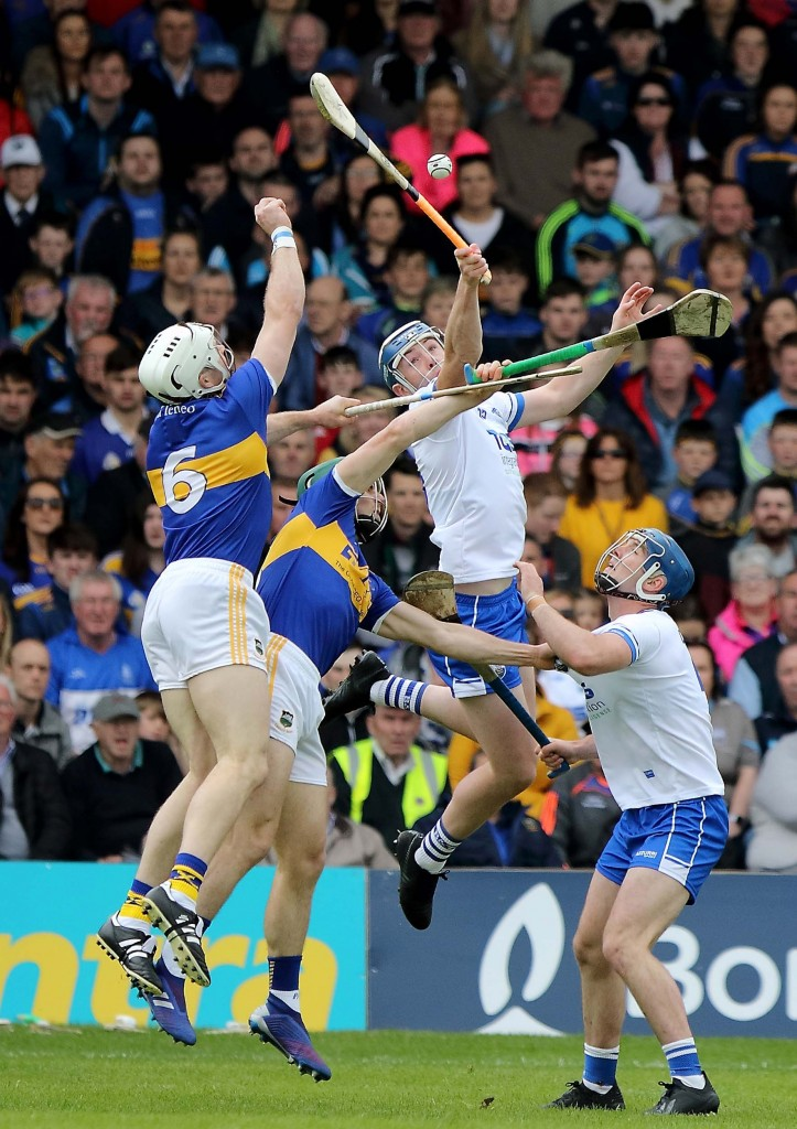 Waterford's Stephen Bennett goes highest in claiming possession above Tipperary's Padraic Maher.