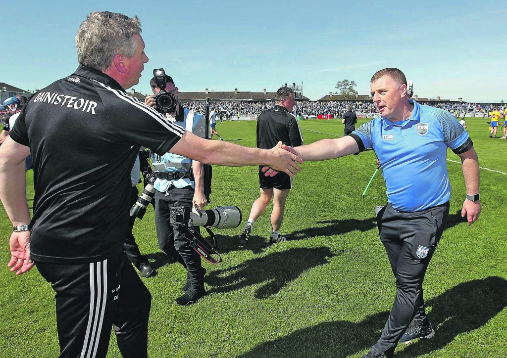 Clare's joint manager Donal Moloney shakes the hand of Déise boss manager Paraic Fanning following last Sunday's final whistle.| Photos: Noel Browne