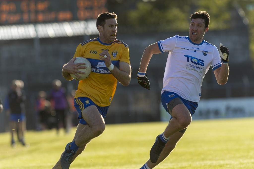 Clare captain Gary Brennan veers clear of Waterford's Tommy Prendergast during last Saturday's Munster SFC Quarter-Final at Cusack Park on Saturday last.| Photos: Eugene McCafferty