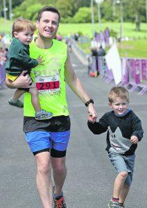Ruairi O'Brien with his sons Jamie and Sam.