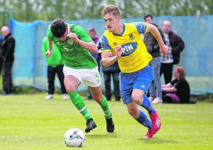 Waterford FC's John Martin takes on Irish Universities Joe Manley.