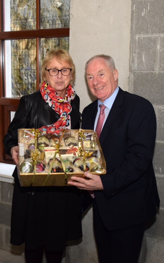 Gerri Hickey presenting Minister Michael Ring with a hamper of locally produced products during his visit to Piltown. Photo: Joe Cashin