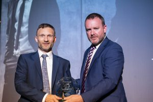 Andrew Collie being presented with the Superstore Manager of the Year Award.