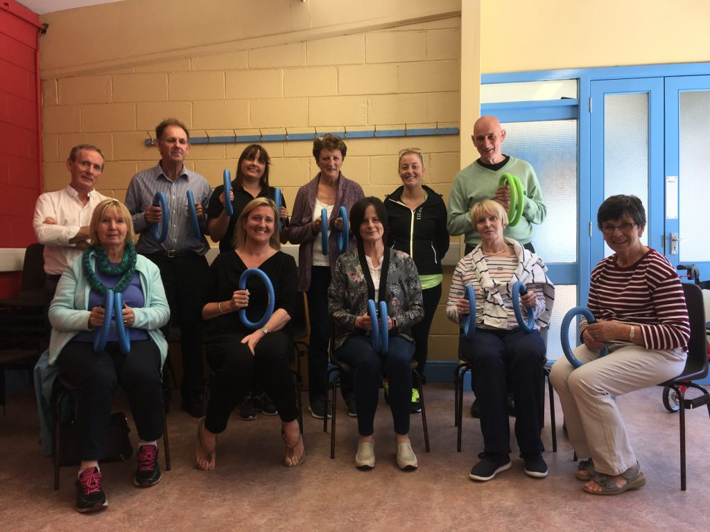 Group pictured with Smovey rings at the final session of the most recent 'Helping People with Parkinson's' course which took place at the Butler Community Centre, St John's Park.
