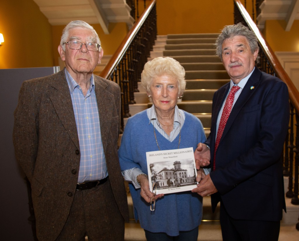 Pictured are Terry Malcomson Crosbie and Carmel O'Regan Crosbie presenting a book to Minister John Halligan which he presented to Bill Bonner, President & Founder of The Agora Companies to mark the recent annoucmenet of 135 new jobs at Agora