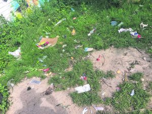 Drug paraphernalia is scattered among litter in New Street Gardens