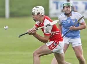 Ballyduff's Oran Leamy in action ahead of Roanmore's Billy Nolan