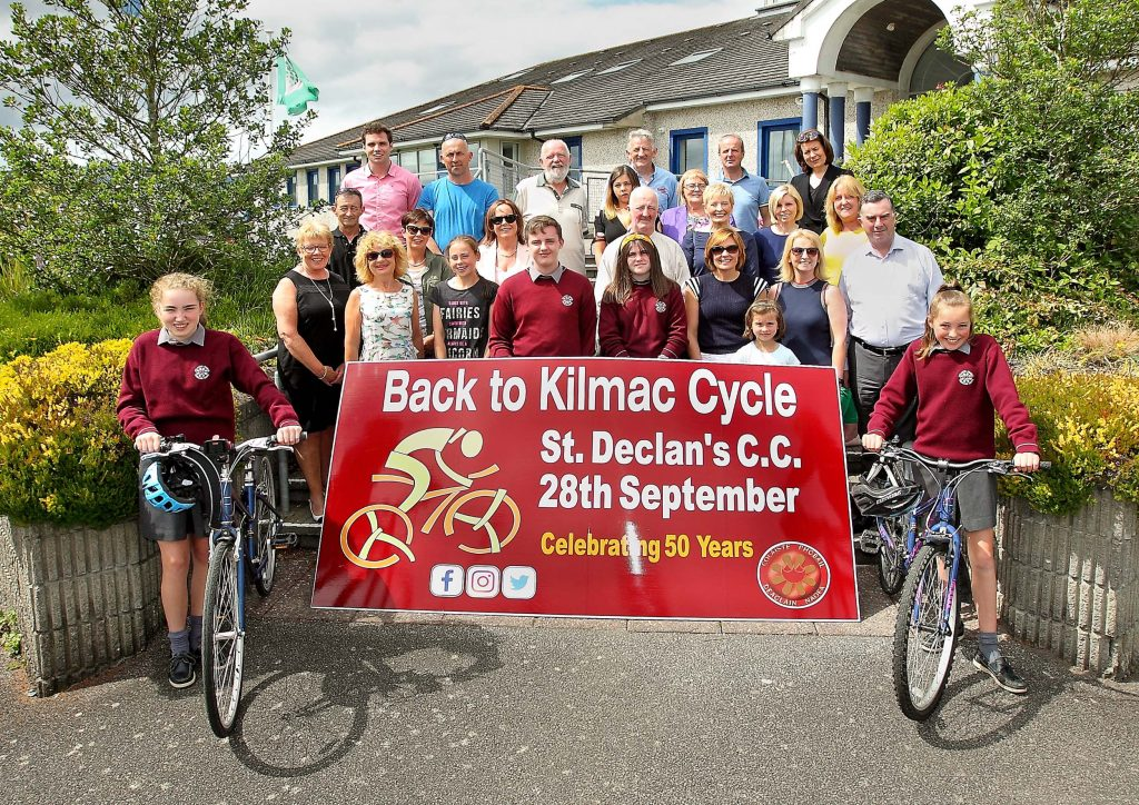 Group pictured at St. Declan's Community College for the launch of the Back To Kilmac Cycle which will take place on Saturday 28th September celebrating 50 years of the school.  Back L-R: Kieran Foley, Norman Bagge, Hugh Kerley, Brian Murray, Neil Kirwan, Grainne Walsh. Middle L-R: Nicky Butler, Claire O'Rielly, Tina Butler, Mary Kiersey, Oliver Coffey, Margaret Dwyer, Bridget Ahearne, Elaine Murray, Aileen Bowdren. Front: Mary Dunbar, Laura Nolan, Jenna Bagge, Mahon Bowdren, Abi Kiersey, Judy O'Gorman, Cara Bagge, Fiona Hennessy and Eugene Power.  Pictured with the bicycles are Elizabeth Kirwan and Keira O'Rielly