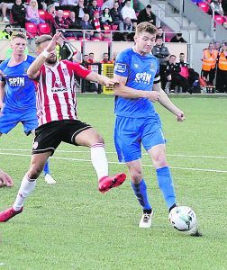 Blues captain Rory Feely shoots for goal against Derry City