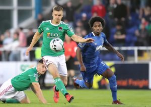 Waterford FC's Walter Figueira chases back after Cork City's Colm Horgan.