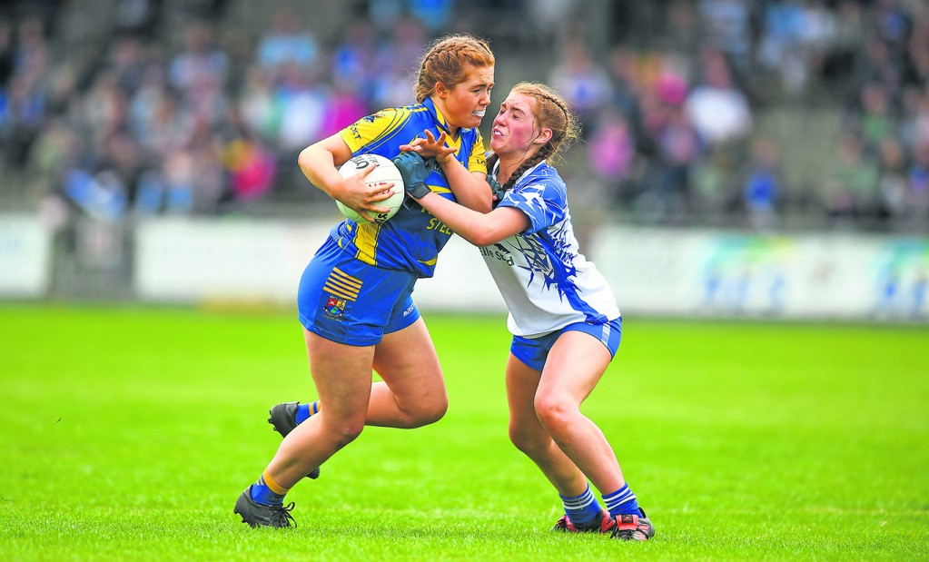 Molly Mulvhill of Longford challenged by Waterford's Megan O'Grady