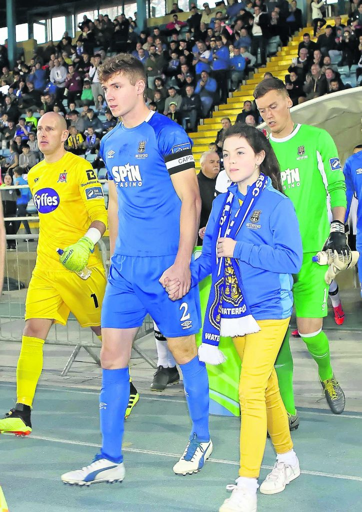 Waterford FC captain Rory Feely leads his team out with mascot, Alexia Kavanagh-Foran.