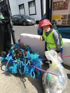 One of Tramore Tidy Towns' young helpers hard at work.