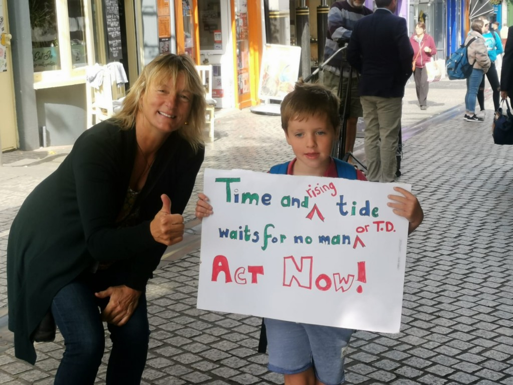 Grace O'Sullivan with a young protestor in Waterford.