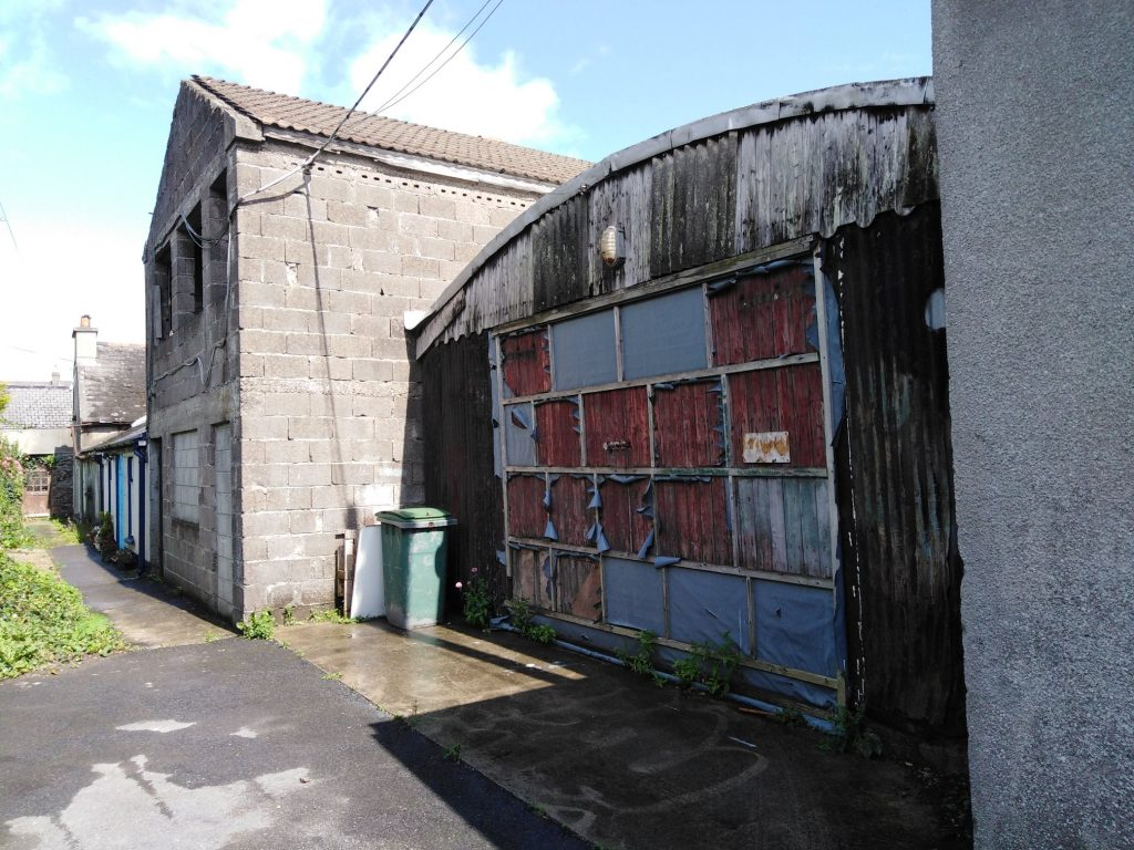 """Cllr Joe Conway has pointed to the """"grim hulks"""" on Post Office Lane as an example of the town's dereliction issue."""