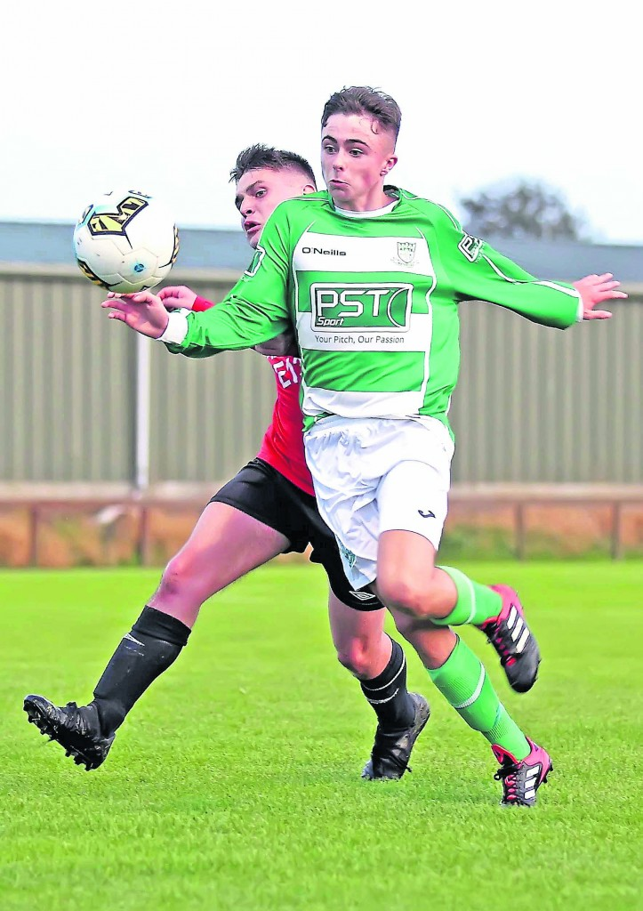 Villa's Ross Connolly holds off the challenge from Portlaw's Darragh Quinn