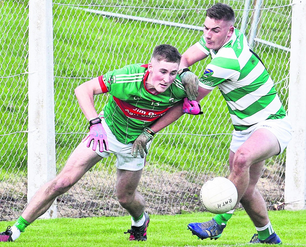 Rathgormack's James Power in action with Ballinacourty's Neil Montgomery