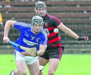 Dungarvan's John Curran holding onto possession against Ballygunner's Barry O'Sullivan